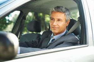 Businessman in car, close up